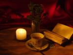 Book, tea and candle